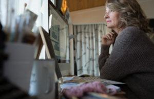 pensive_older_woman-750x485